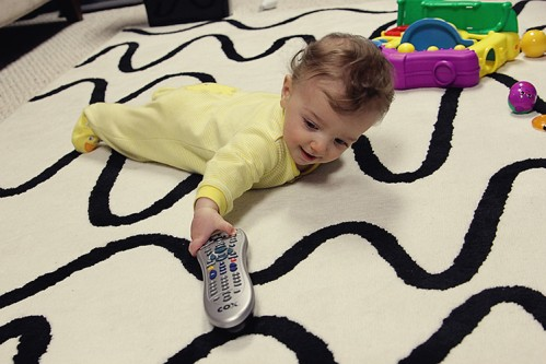 baby boy reaching for tv remote