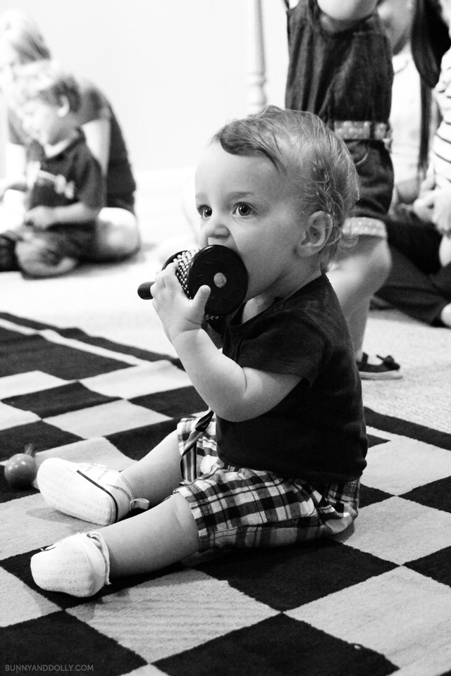 Baby playing with musical instrument