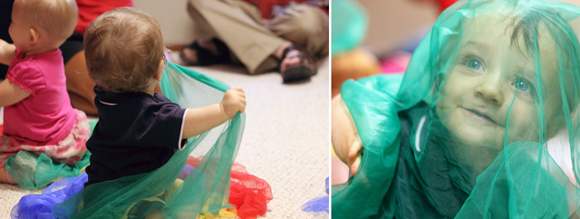 toddler playing with scarves