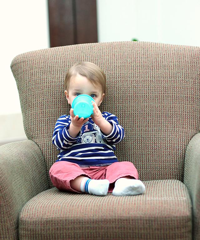 Toddler Boy Drinking Milk in Oversize Chair