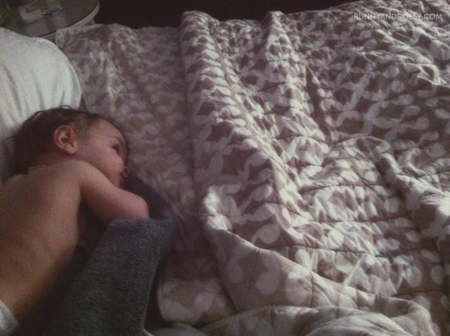 Toddler wearing diaper sick in bed