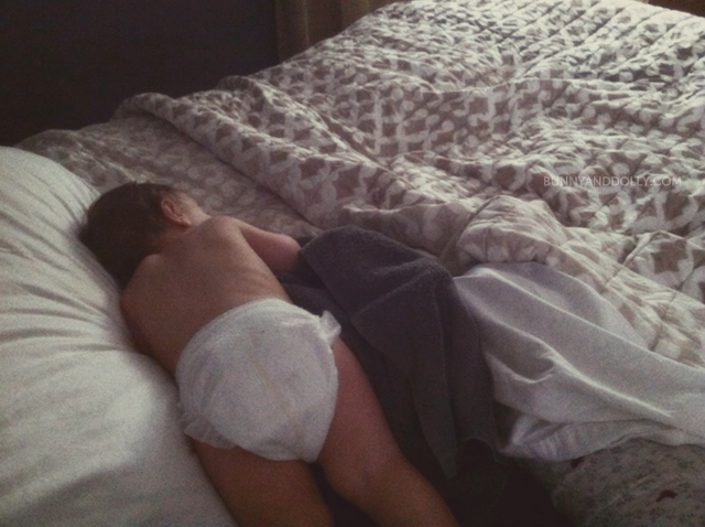 Toddler wearing diaper sick in bed