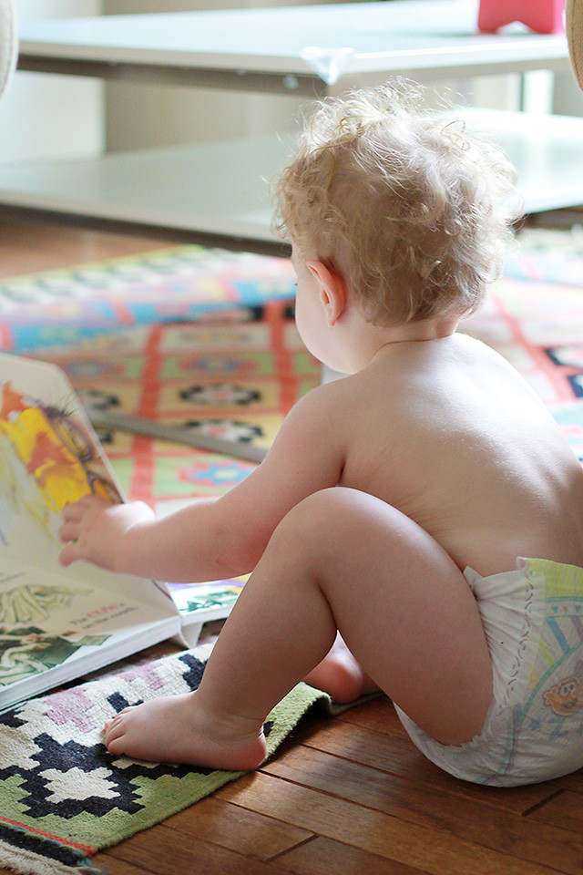 Reading board books in Pampers Cruisers at 18 months old | A Girl Named PJ