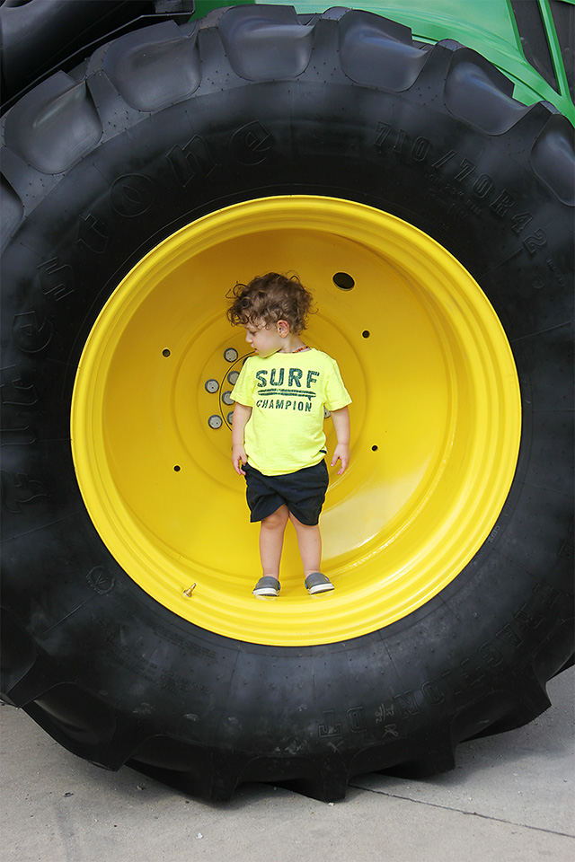toddler inside tractor wheel at iowa state fair