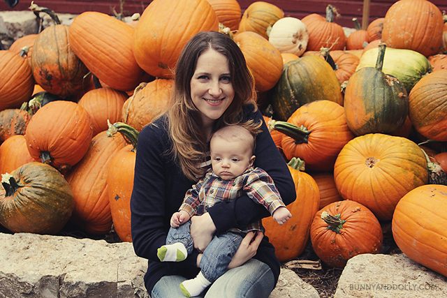 Mom and Baby in Pumpkin Patch