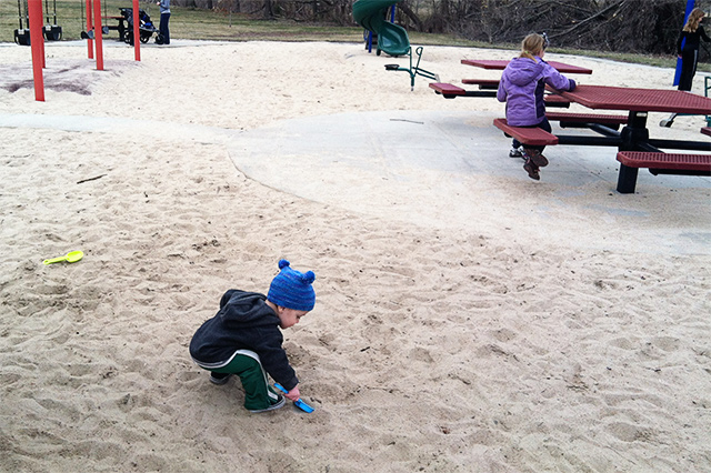 toddler playing in sand at playground | bunnyanddolly.com
