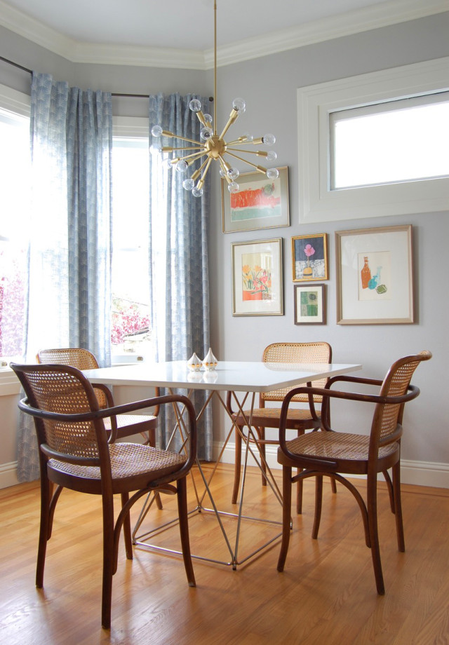 A mid-century modern Sputnik chandelier hangs over a table