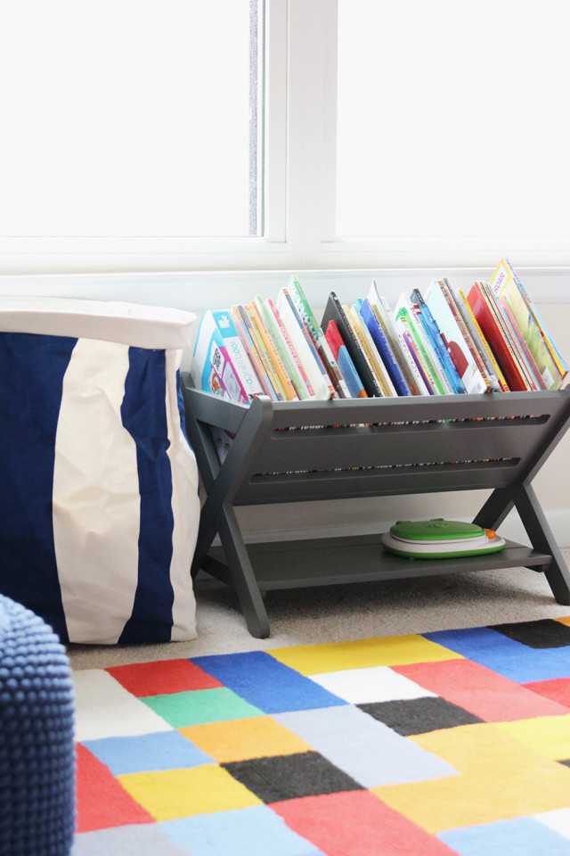 The Land of Nod bookcase and toy storage in a boys' shared bedroom