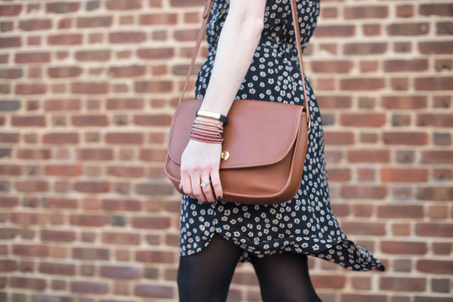 Wearing a Nakamol wrap bracelet and a vintage Coach turnlock purse with a floral spring dress from Madewell