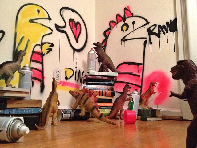 Dinovember - toy dinosaurs spray painting walls