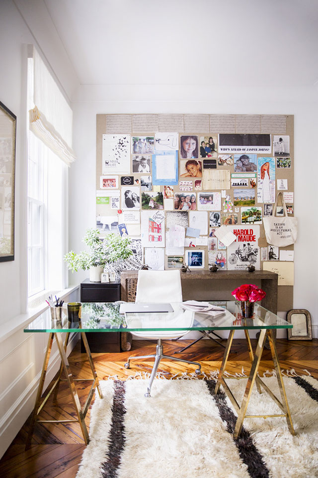 NYC brownstone desk with giant inspiration board