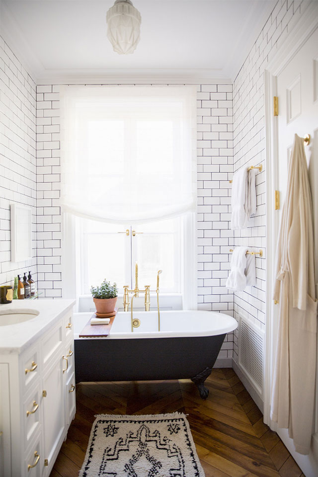 NYC brownstone bathroom with white subway tiles