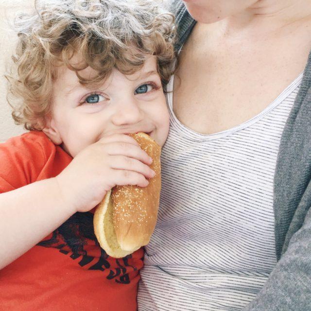 Toddler eating hot dog bun