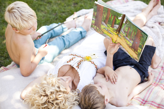 mom and sons reading together