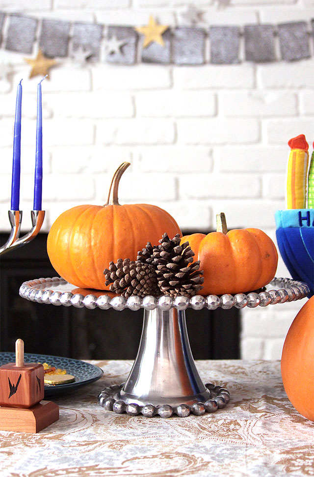 thanksgivukkah decorations with pumpkins and pinecones