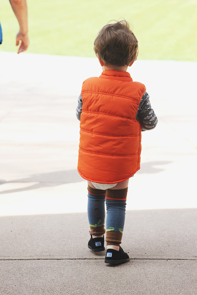 toddler wearing vest outside