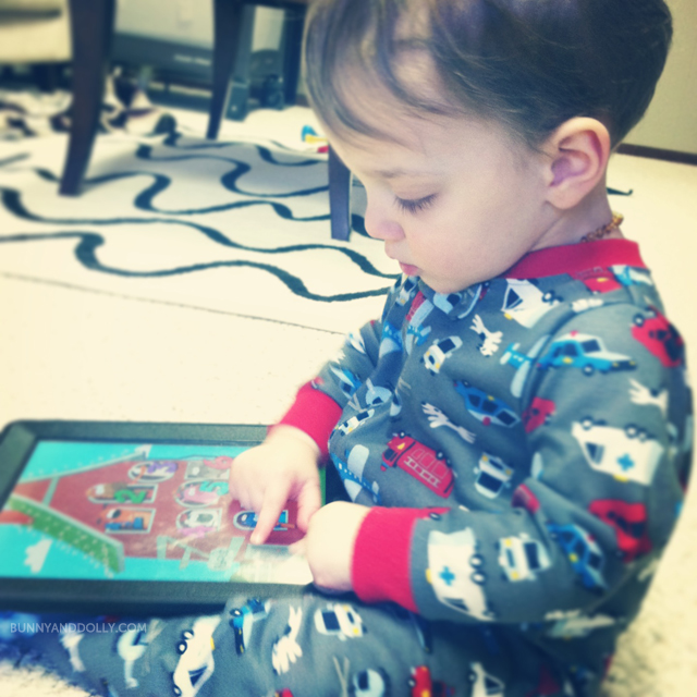 toddler-playing-ipad-bunny-and-dolly