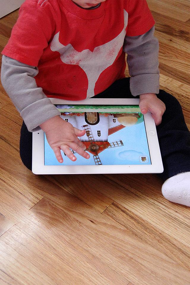 toddler playing ipad